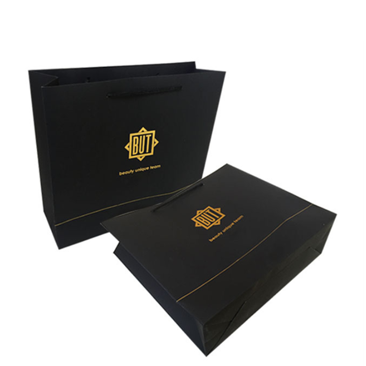 Wholesale customized gold foil logo black shopping paper bag