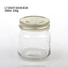 Clear glass mason canning jar with metal lid