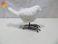 Ceramic white glazed bird with metal feet decoration