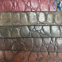 Elastic faux leather with embossed pattern