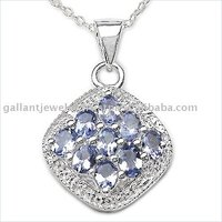 Regally designed and elegantly crafted sterling silver pendant with tanzanite rounds embedded to add to gleam!!