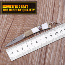 Manufacturers selling outdoor camping knife knife stainless steel blade freshwater shell abalone shell, with key ring chain fold