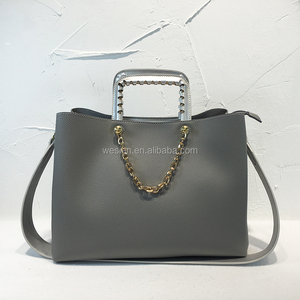 Fashion handbag with nice metal gold elegant chain, Tote bag with three pocket with smoothly zipper And wide shoulder strap bag
