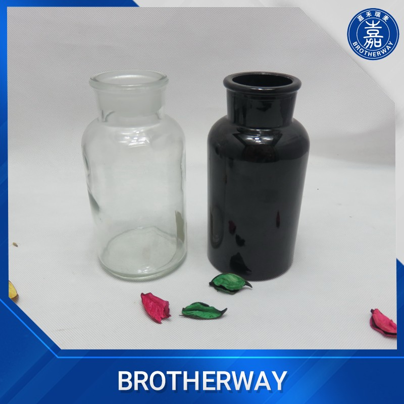 wholesale black round Medicine storage glass bottle with glass cork