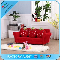 Kids 3 seat velvet sectional sofa with strawberry pillows