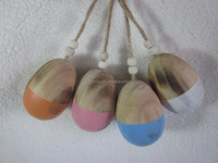 4 ASSORTED HAND HALF PAINTED WOOD EGG