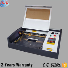 China Hot Sale JK4040 CO2 Laser Engraving Cutting Machine for Iphone Plywood etc Price