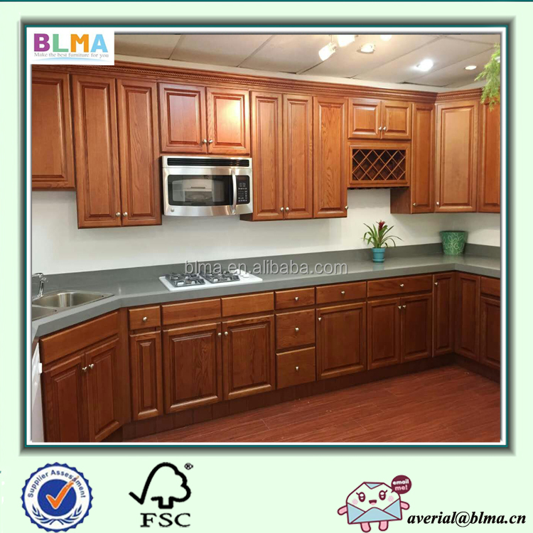 white shaker wood kitchen cabinets