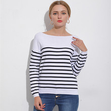 The new women's knitwear is a knitted sweater with a stylish black and white stripe