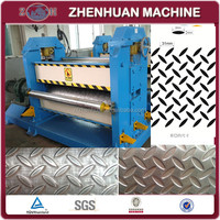 Roller type stainless steel embossing machine