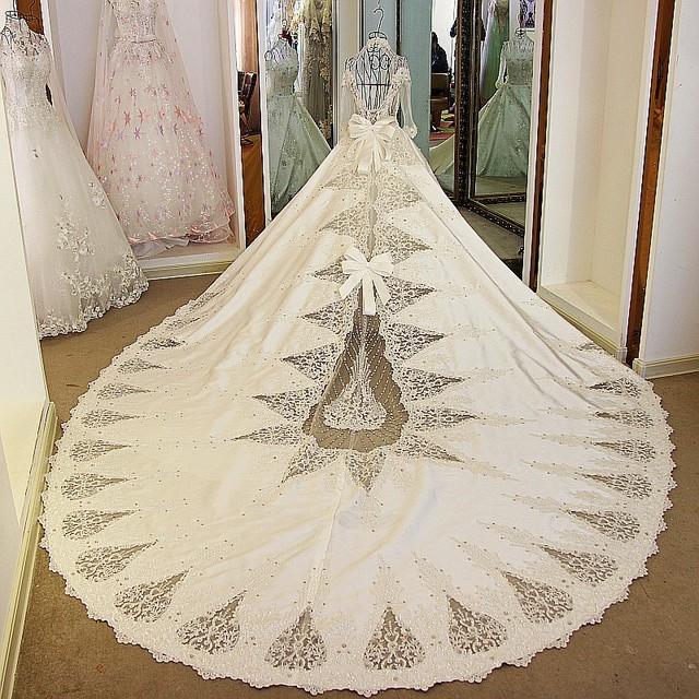 LS99229 Slim high neckline long sleeve luxury beaded keyhole bow baby girl lace fabrics alibaba wedding dress