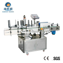 HJL-T21100 automatic tumbling type vertical round bottle labeling machine for bottles
