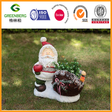 Christmas Santa statue holding apple with rattan flower pot for garden decoration