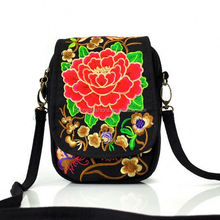 The new Yunnan ethnic wind flip embroidered bag wholesale features embroidery mini bag purse mobile phone bag