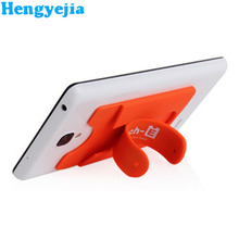 China Top Ten Selling Products 3M Sticky Hand Cell Phone Stand Silicon Mobile Phone Card Holder