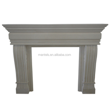 Wood burning natural limestone surround traditional fireplace