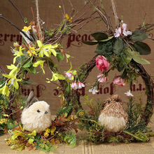 handmade decorative hanging Christmas wreath with bird