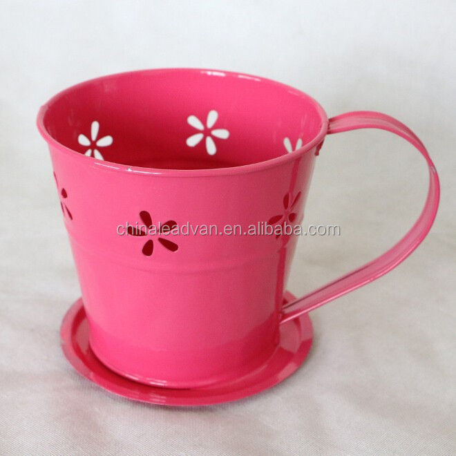 lovely metal tea cup and saucer flower pot