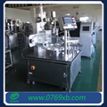 Rotary table plastic cup filling and sealing machine