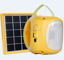 Portable LED solar lantern for home and outdoor or camping use with mobile phone charger