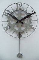 Metal wall gear clock in antique grey color with pendulum