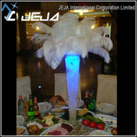 Floral decoration / white ostrich feathers wedding centerpieces with led light