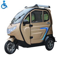 Three wheel covered disabled motorcycle