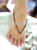 Barefoot sandal made from elastic nylon and wooden beads