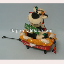 Pulling car cow doll