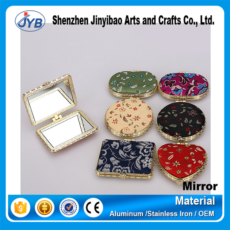 wholesale fashion style fabric frame antiquities silk folding mirror for sale