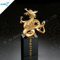 Elegant golden metal dragon trophies with black crystal base