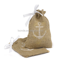 small burlap drawstring bag with white anchor design
