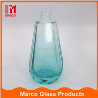 blue colored in stock wholesale pump spray refillable 100ml glass perfume bottle