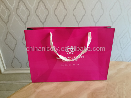 red paper gift bag with handles