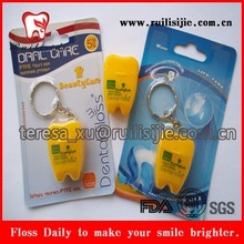 Key chain tooth shaped dental floss