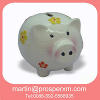 Ceramic piggy coin bank that counts money