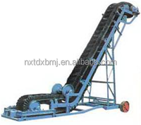 Corrugated sidewall belt conveyor for many different types of bulks