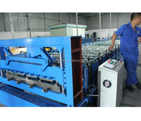Structural roll forming machine, trapezoidal roof panel roll former