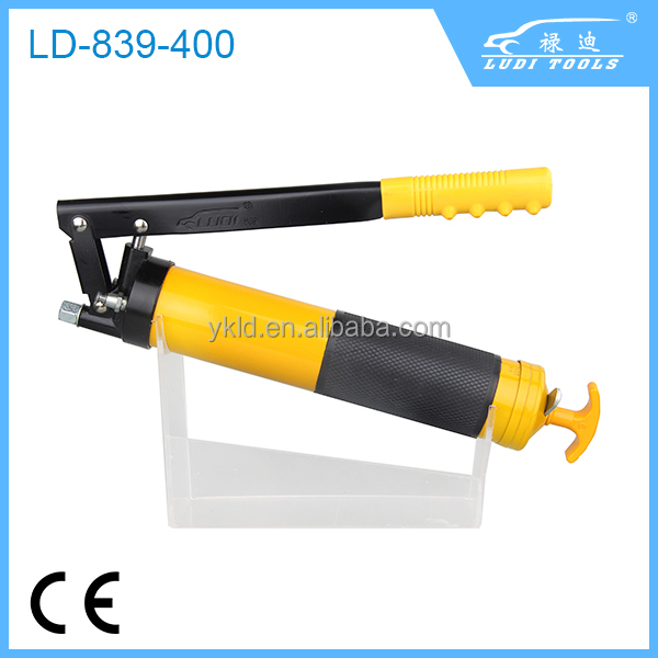 hand operated grease gun in plastic coping