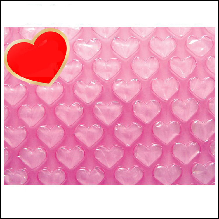 Wholesale bubble cushion film pink heart shaped air bubble sheet plastic bubble padded roll