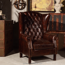 Vintage Distressed Leather Bandaged Wing Back Armchair