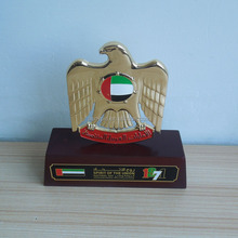 UAE falcon trophy with wooden base