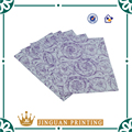 MG tissue paper with flowers/company logo