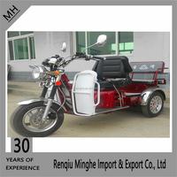 Adult motorcycle trike with open body for passenger