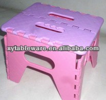 plastic fold up chair and plastic stools