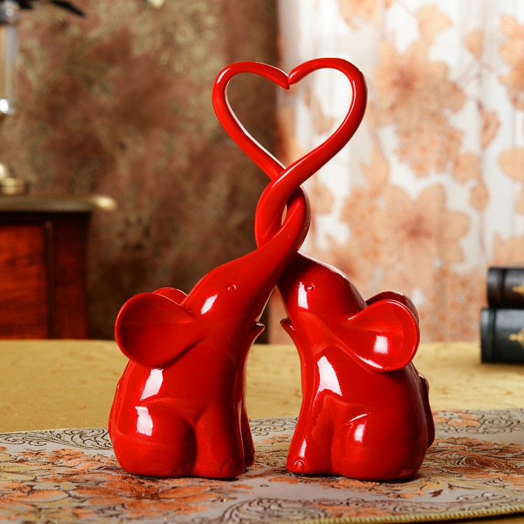 China artificial heart-shaped resin double elephant figurines for wedding decorations