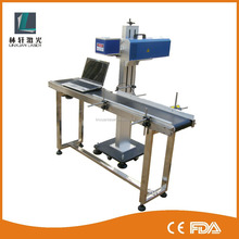 China manufacture wholesale high speed 10w 30w 60w 100w online fly co2 laser marking machine/service