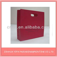 2012 fashionable red paper bag/clothes packaging bag