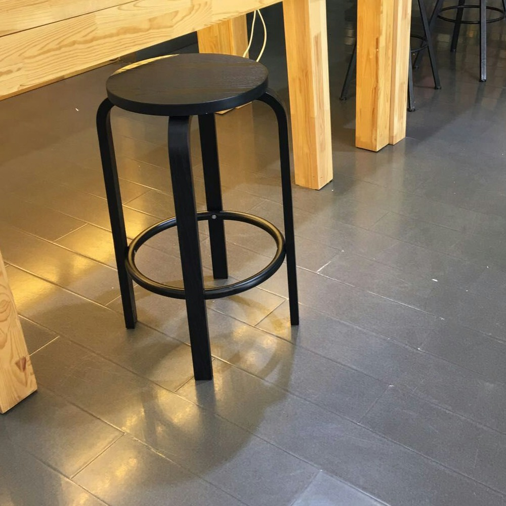 black wooden stool for apple mobile phone display