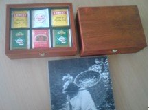 Gift wood box with different herb and tea bags in envelops
